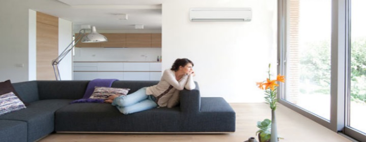 Lady on couch in home with air con